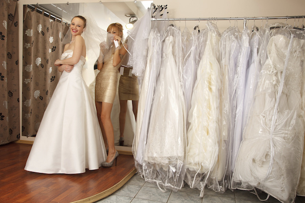Bride trying on dresses