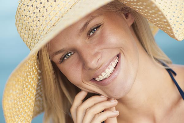 ceramic braces on girl with straw hat