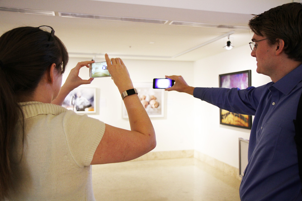 Experiencing augmented reality at the Art Museum of South Texas are Karol Stewart, the museum's coordinator of community services, and Dr. David Squires, assistant professor in the Master of Science Program in IDET at Texas A&M University-Corpus Christi. Courtesy photo